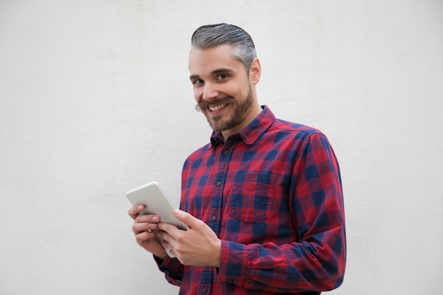 Content man with digital tablet smiling