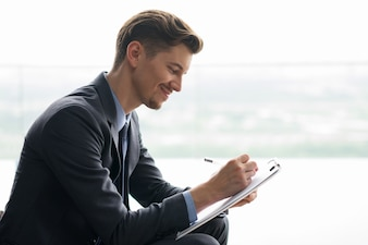 Content Middle-aged Businessman Making Notes