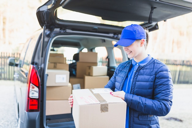 Content woman working in courier service
