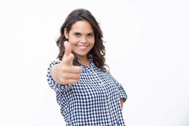 Content young woman showing finger gun symbol