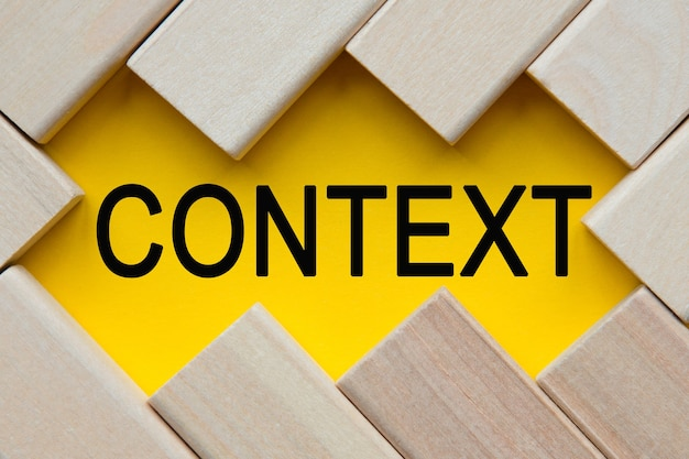 Context text on yellow with cubes