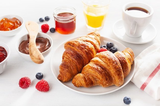 Continental breakfast with croissant,  jam, chocolate spread and coffee