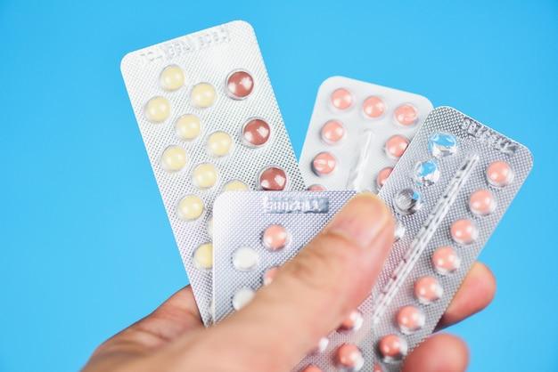 Contraception methods concept / woman holding contraception pills birth control contraceptive means prevent pregnancy