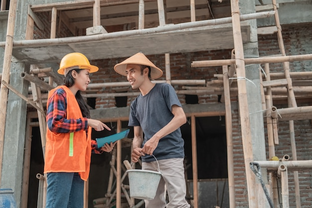 Contractor and builder discussion about building sketches in the building construction background