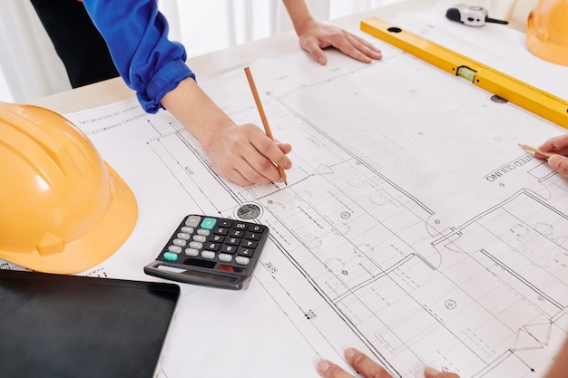 Contractor examining building blueprint
