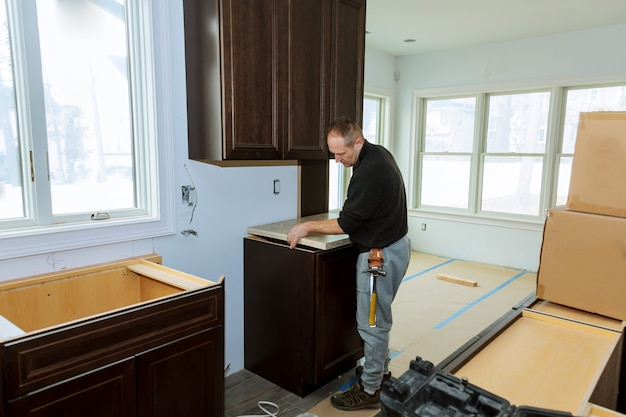 Contractor installing a laminate counter top during a kitchen remodel