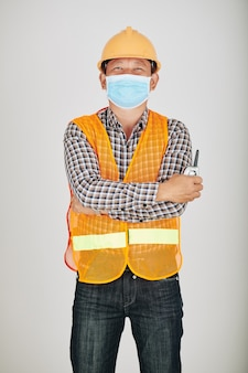 Contractor in safety vest and medical mask