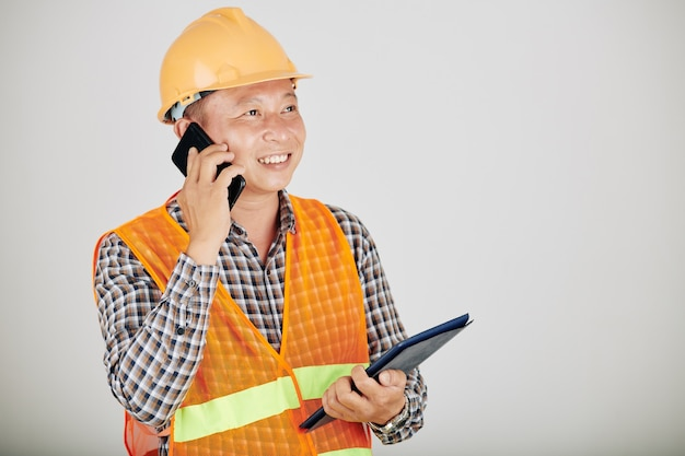 Contractor talking on phone