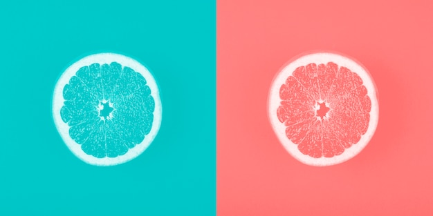 Contrast blue and coral backdrop with grapefruit slice