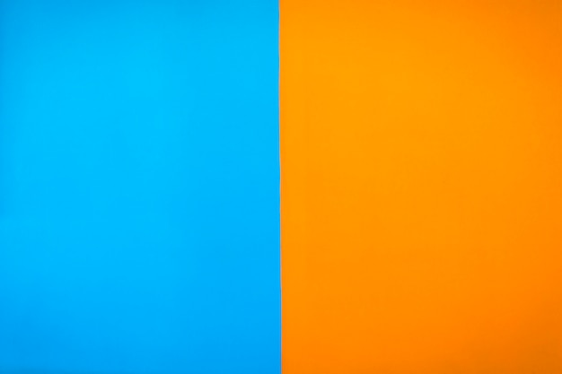 Contrast painted blue and orange color wall background