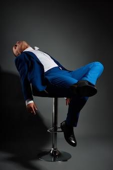 Contrast portrait of a man businessman in an expensive business suit