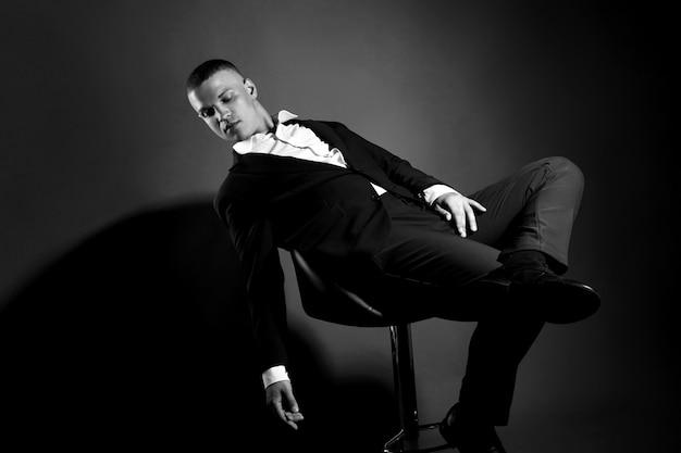 Contrast portrait man businessman in expensive business suit