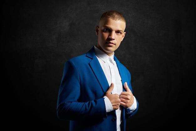 Contrast portrait of a man businessman suit