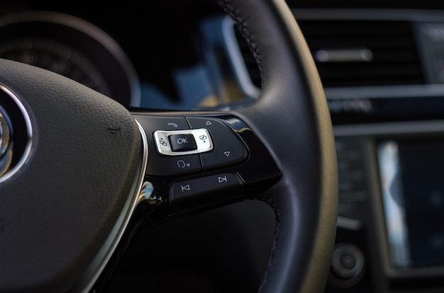 Control buttons of handsfree and audio on the steering wheel of a car