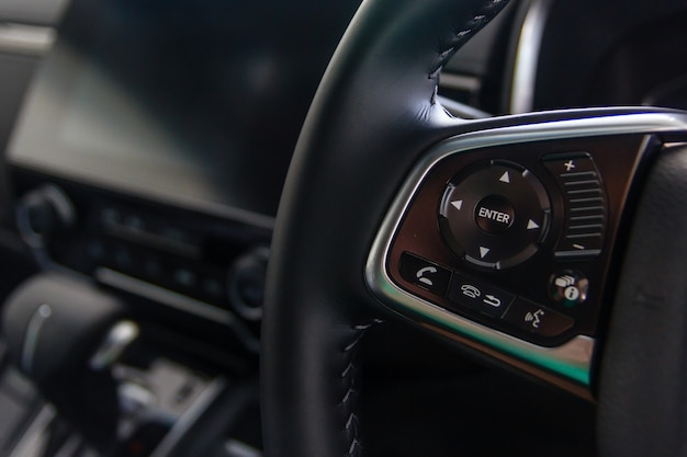 Control buttons on steering wheel, car interior.