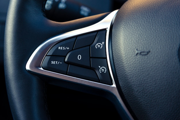 Control buttons on the steering wheel of a modern car
