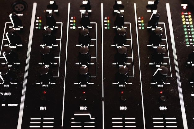 Control panel with sliders of an audio mixer for dj