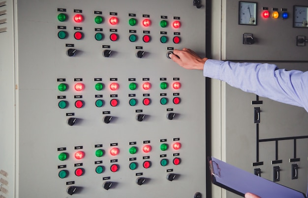 Control room engineer. power plant control panel.