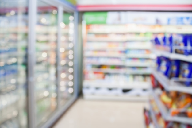 Convenience store refrigerator shelves blurred background