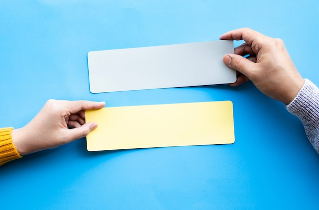 Conversation talk or word of mouth concepts with male hand holding blank paper.