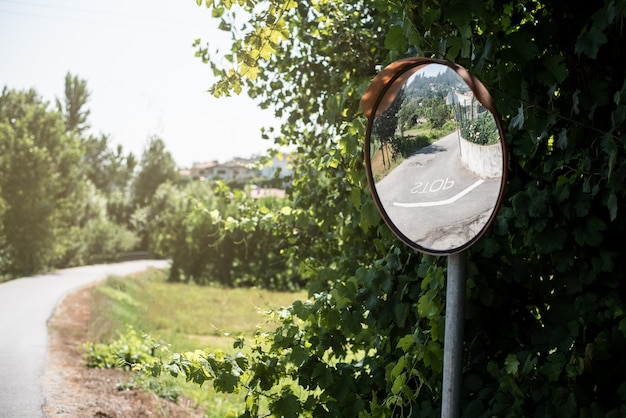 Convex safety mirror ina rural road