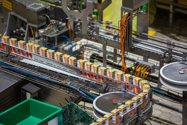 Conveyor belt, milk in bottles on beverage plant or factory interior in the industrial production line.