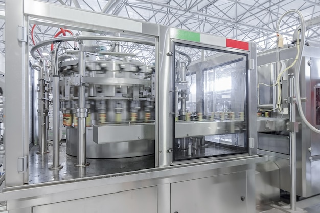Conveyor belt in motion at production and bottling of drinks in tin cans