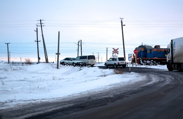 A convoy of cars at the railway crossing