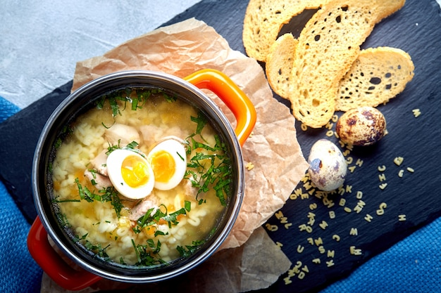 Cook noodles soup with egg in a small saucepan. healthy meal.
