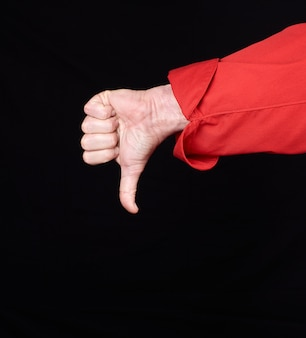 Cook in red uniform  shows gesture dislike with hands