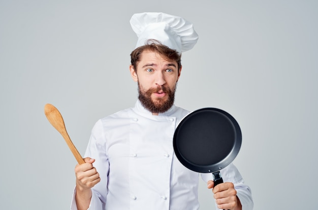 Cook with cooking utensils frying pan restaurant cooking
