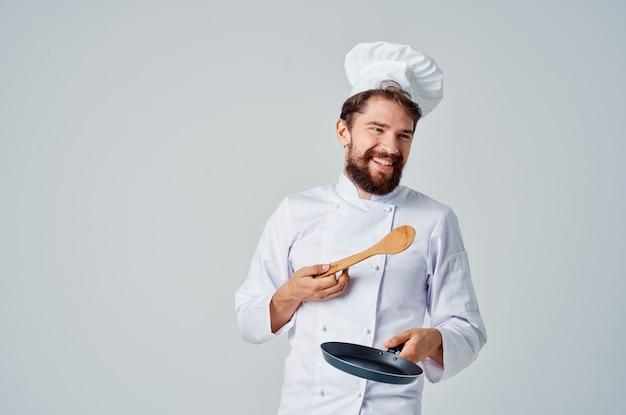 Готовить с посудой ресторан кухня работа. фото высокого качества