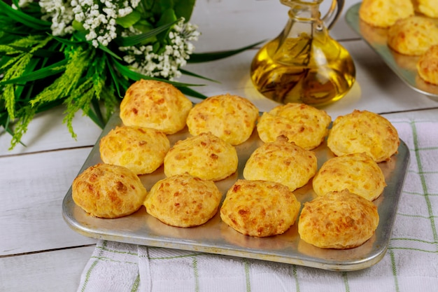 Cooked brazilian cheese bread in baking pan with oil.