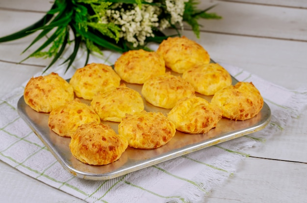 Cooked brazilian cheese bread chipa in baking pan.