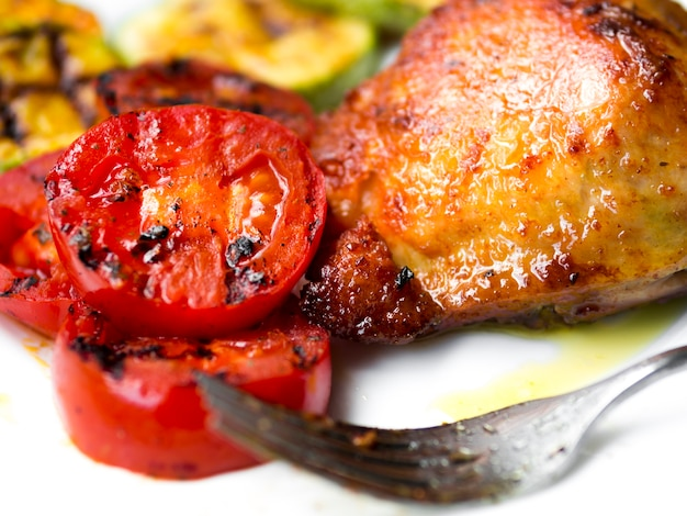 Cooked chicken legs with tomatos