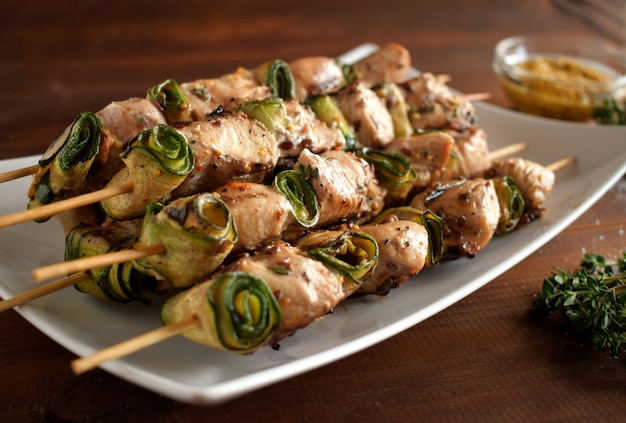 Cooked chicken meat skewers.