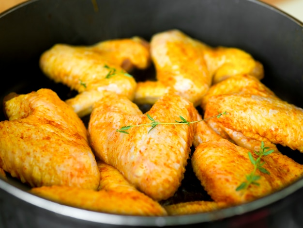 Cooked chicken wings with herbs