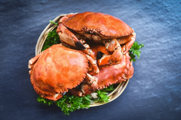 Cooked crab on steamer and dark