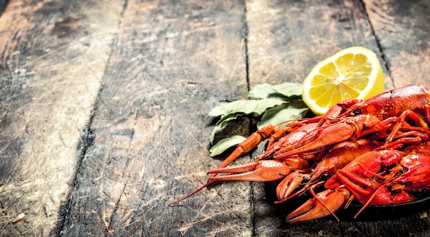 Cooked fresh crayfish. on a wooden background.