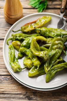 Cooked green sweet italian pepper