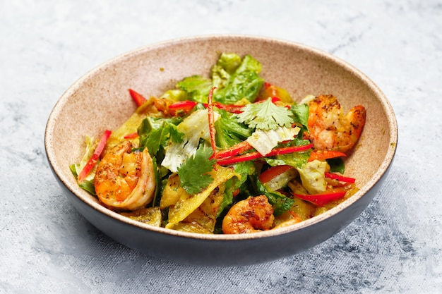 Cooked healthy salad with fried shrimp red paprika