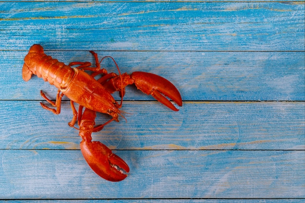 Cooked lobster with dinner on wooden background