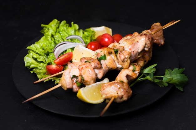 Cooked meat and veggies kebab high view