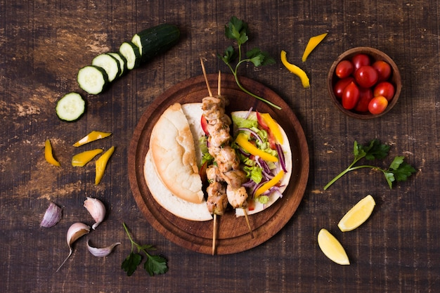 Cooked meat and veggies kebab long view
