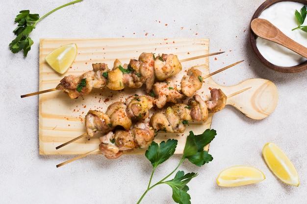 Cooked meat and veggies kebab on skewers