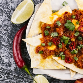 Cooked mexican burrito with hot pepper