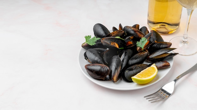 Cooked mussels and cutlery