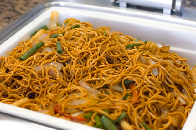 Cooked noodles with vegetables in soy sauce