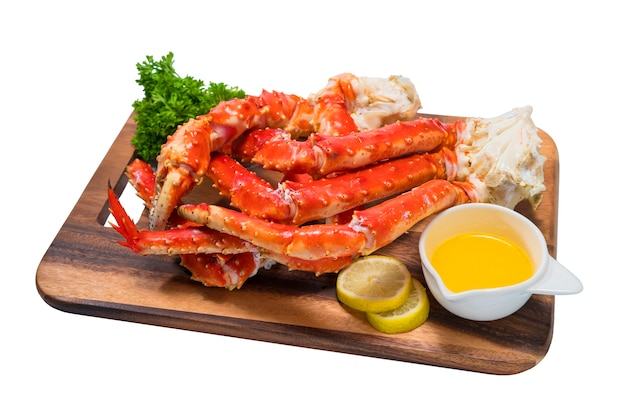 Cooked organic alaskan king crab legs with butter and lemons,alaskan king crab on wood plate