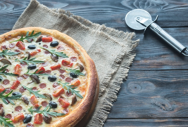 Cooked pizza on wooden table